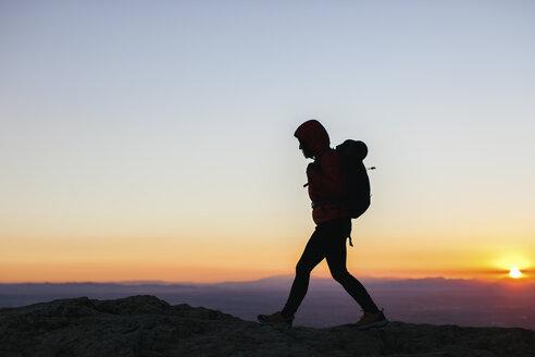 Spain, Catalunya, Girona, woman hiking at sunrise - EBSF001169