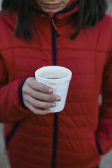 Woman holding cup with hot beverage - EBSF001175