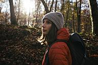 Spain, Catalunya, Girona, female hiker in the woods looking around - EBSF001202