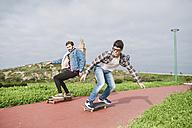 Spain, La Coruna, two friends skateboarding - RAEF000724