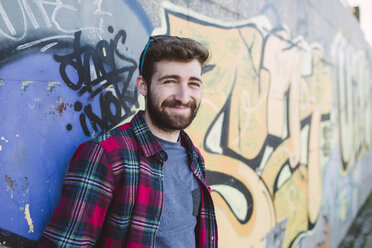 Spain, La Coruna, portrait of smiling hipster - RAE000736