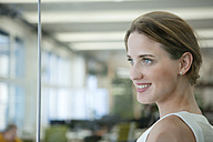 Confident businesswoman in office - WESTF021617