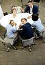 Smiling businesspeople having a meeting in office - WESTF021626
