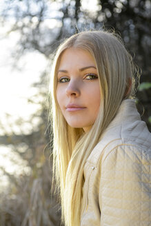 Portrait of blond young woman in nature - BFRF001702