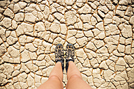 Namibia, Namib Desert, Sossusvlei, Trekking shoes on dry cracked earth - GEMF000562