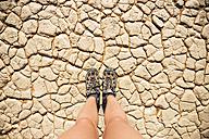 Namibia, Namib Desert, Sossusvlei, Trekking shoes on dry cracked earth - GEMF000562
