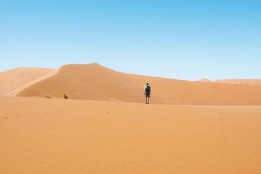 Namibia, Namib Desert, Sossusvlei, Man  walking through the dunes - GEMF000565