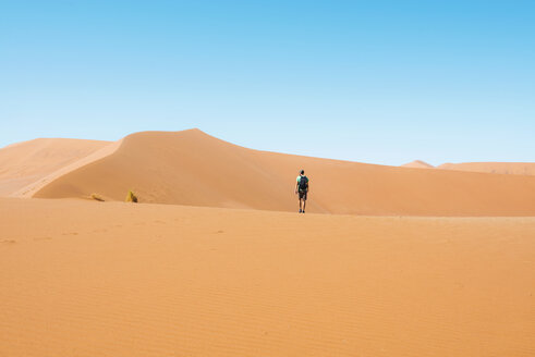 Namibia, Namib Desert, Sossusvlei, Man  walking through the dunes - GEMF000565