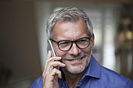 Smiling mature man on cell phone - RBF003650