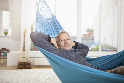 Mature man at home lying in hammock - RBF003674