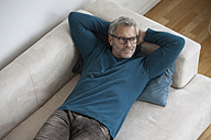 Relaxed mature man at home lying on couch - RBF003704