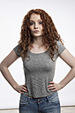 Portrait of redheaded teenage girl with hands on hips - GDF000948