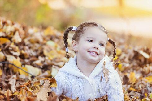 Happy girl in autumn leaves - HAPF000058