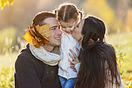 Happy family hugging in autumnal park - HAPF000082