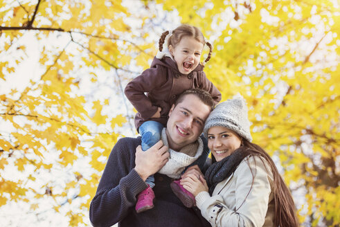 Happy family in autumnal park - HAPF000091