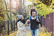 Family going for a walk in autumnal park - HAPF000094