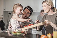 Family in kitchen preparing food together - ZEF007692