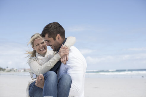 Couple on a beach - ZEF007710