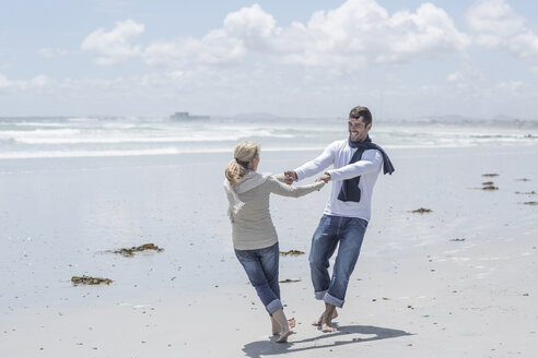 Couple having fun together on a beach - ZEF007716