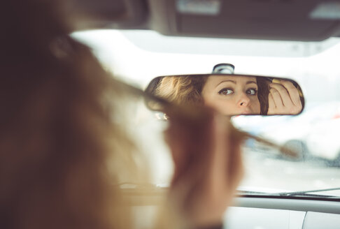 Woman applying make up in car - OIPF000048