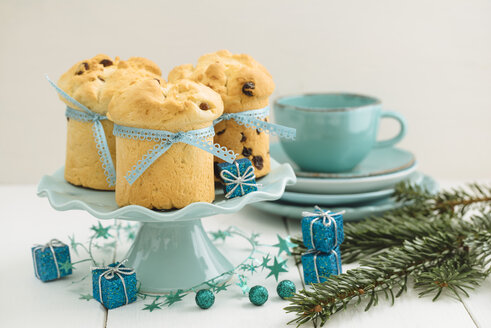 Home-baked mini panettone on cake stand, Christmas decoration - ECF001837