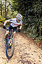 Mountain biker driving in the forest - MGOF001213