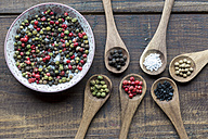 Wooden spoons of different peppercorns and Hawaiian lava salt and berg crystal salt - SARF002415