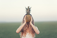 Blonde woman holding pineapple - JPF000089