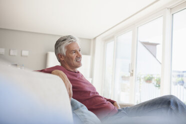 Mature man relaxing on the couch at home - RBF003803
