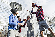 Young men playing basketball - UUF006273