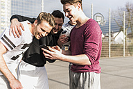Young football players with smartphone - UUF006315
