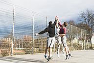Young men playing basketball - UUF006318