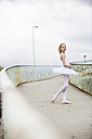 Germany, Cologne, girl wearing tutu standing on footbridge - JATF000806