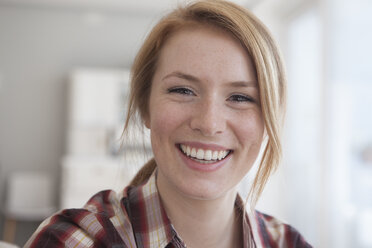 Portrait of happy young woman with freckles - RBF003889