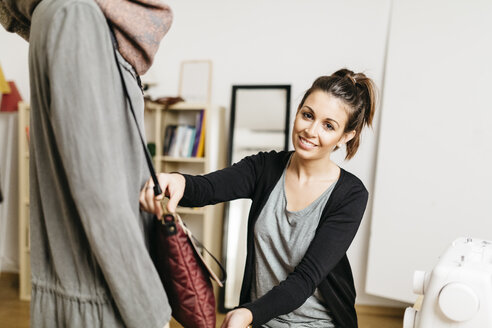 Young fashion designer working in her studio - JRFF000273