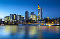 Germany, Hesse, Frankfurt, View from Schaumainkai, Skyline with bank buildings in the evening - AMF004624