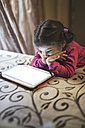 Little girl using digital tablet at home - JASF000332