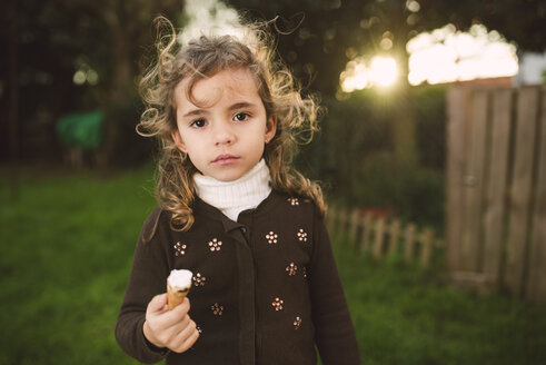 Portrait of little girl with ice cream cone in her hand - RAEF000763