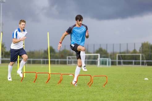 Two soccer players exercising on sports field - SHKF000391