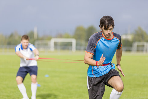 Two soccer players exercising on sports field - SHKF000394