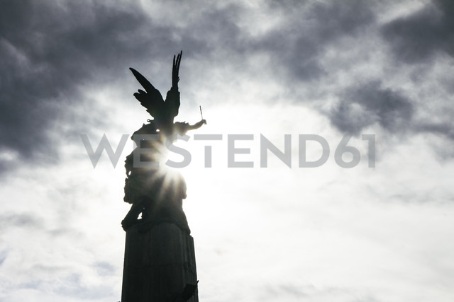 Spain, Vitoria, view to statue of an angel at backlight - ABZF000179
