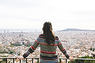 Spain, Barcelona, back view of woman looking at view from Turo de la Rovira - GEMF000590