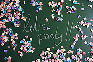 Colorful let's party message written on a blackboard with confetti - GEMF000593