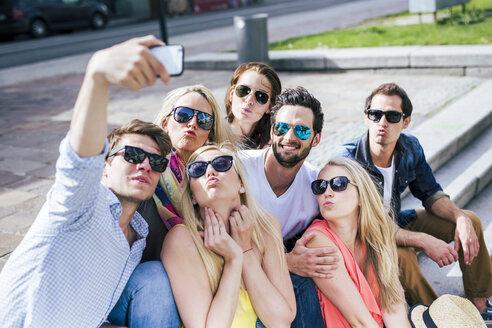 Happy friends wearing sunglasses taking a selfie outdoors - DAWF000460
