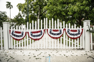 USA, Florida, Fort Myers, gate with flags - CHPF000174