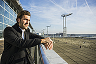 Germany, Frankfurt, Young businessman at the airport - UUF006326