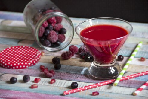 Glass of red fruit smoothie made of berries - YFF000503