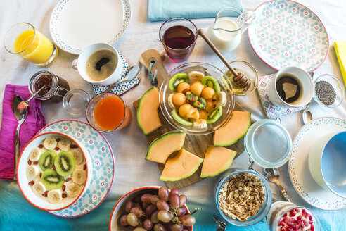 Laid breakfast table with muesli and fruits - SARF002427