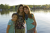 Germany, Mirow, group picture of three girls in front of Lake Mirow - LBF001343