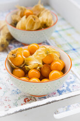 Physalis in bowl on tray - LVF004388
